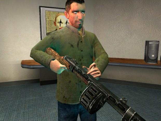 A guy admiring his gun
