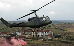 Bell UH-1D (Medevac) overflies the battlefield