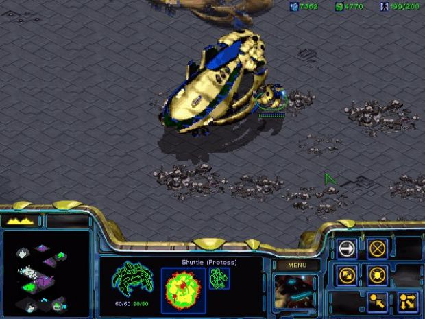Protoss Shuttle protected by a Mothercarrier