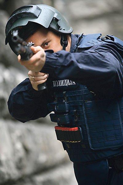Swiss or Russian Altyn Helmet on Serb police? image